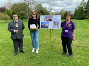 Photograph of Lauren being presented her prize by the Mayor of Wokingham and a representative from Home Start
